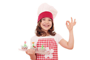 happy little girl cook with spring flowers muffins and ok hand s