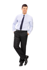 Casual young businessman leaning against a wall