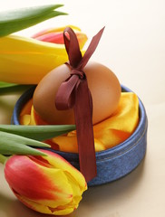decorated eggs and spring flowers tulips, of Easter holiday