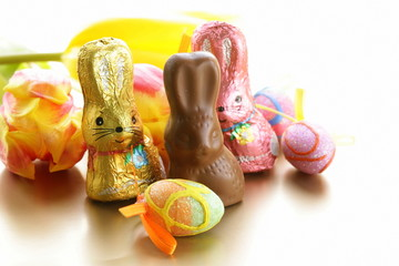 chocolate Easter bunny candy (sweets) with tulips