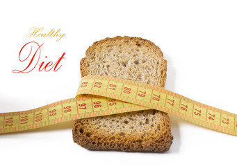 slice of wholemeal toast with tape measure isolated