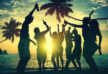 Group of People Enjoying Party on the Beach Together Concept
