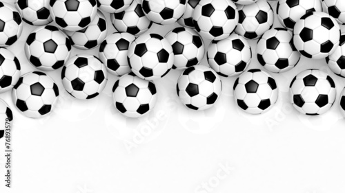 canvas print picture Pile of classic soccer balls isolated on white with copy-space