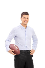 Young man holding an American football