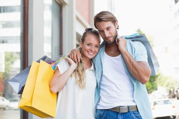 Attractive couple looking at shopping purchases