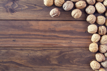 Walnuts in shells on a board