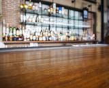 Fototapety Top wooden table with Bar Blurred Background
