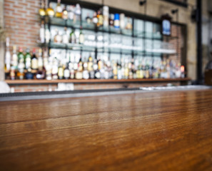 Top wooden table with Bar Blurred Background