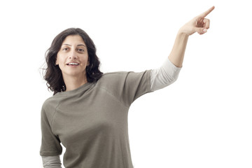 Portrait of woman pointing up