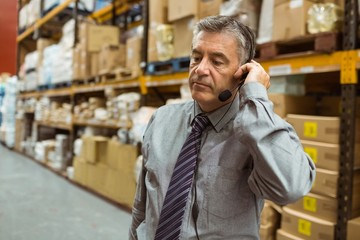 Focused manager talking in a headset