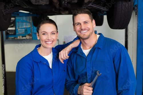 Team of mechanics smiling at camera