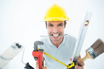 Happy worker with various equipment