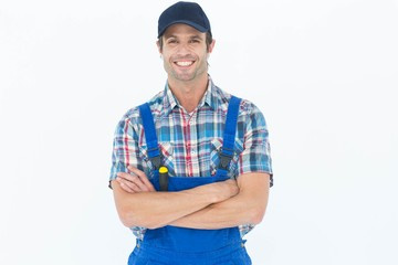 Confident plumber with arms crossed