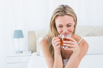 Beautiful blonde enjoying hot beverage