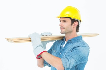 Carpenter carrying wooden planks over white background
