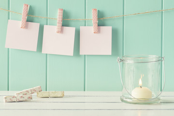 Three sheets of paper hanging on clothespins. Vintage