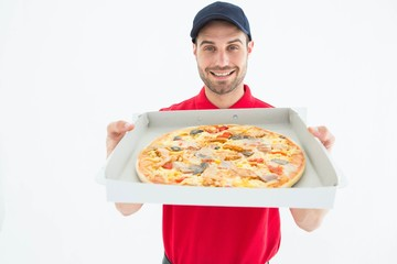 Happy delivery man showing fresh pizza