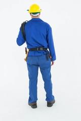 Full length rear view of repairman