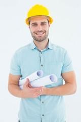 Happy male architect holding blueprints