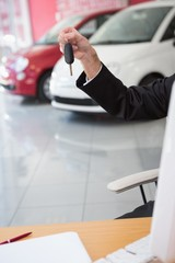 Close up of businessman holding car key