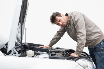 Stressed man looking at engine