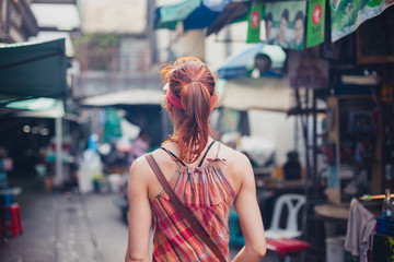 Woman walking in the street in Asia