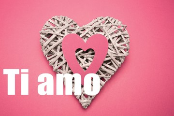 Composite image of wicker heart ornament with paper cut out