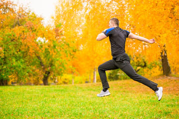 man in sportswear jumps high during exercise