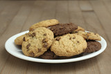 chocolate chip cookies on a plate on a wooden background