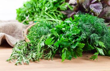 Kitchen herbs on wooden table