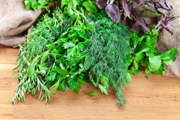Kitchen herbs on wooden table