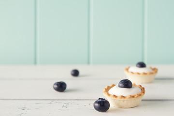 Tartlets with blueberries and greek yogurt. Vintage look.