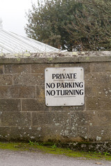 Private no parking and no turning sign