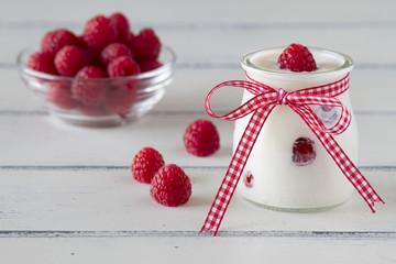 Delicious breakfast with yogurt and raspberries