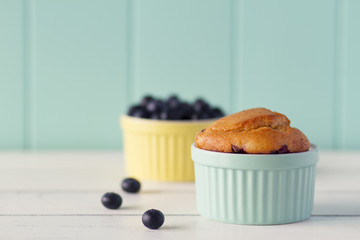two classic whiteware baking bowls with a muffin and blueberries