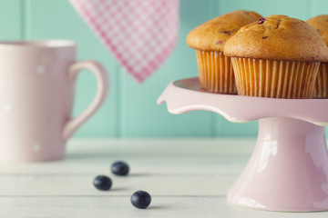 Blueberry muffins in a cakestand. Vintage look.