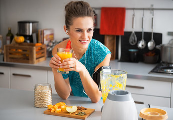 Happy fitness young woman with pumpkin smoothie