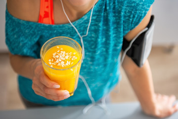Close-up on fitness young woman with pumpkin smoothie
