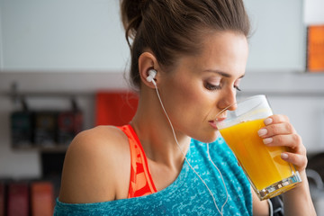 Portrait of fitness young woman drinking pumpkin smoothie