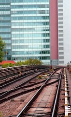 skyscraper and the rails of the train for commuter transport in