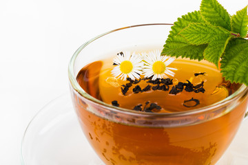 Glass Cup Tea with Mint Leaf and camomile flower Isolated on Whi