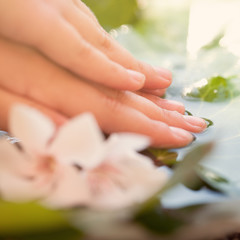 Manicure background with hand and water