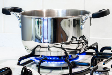 a steel pot on the stove