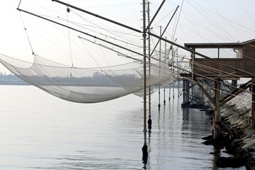 fishing nets over the pile dwellings