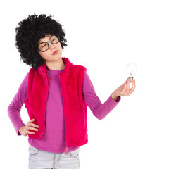 Thinking nerdy girl holding a light bulb