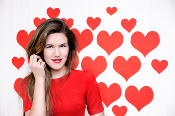 Woman red lips standing on heart background.Valentine`s day