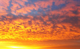 Sky with dramatic cloudy sunrise