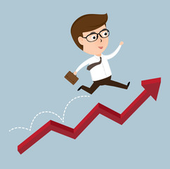 Happy Businessman jumping over growing chart