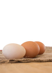 White and Brown  Eggs on Background