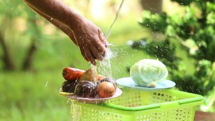man wash different vegetables for cooking ukrainian borsch